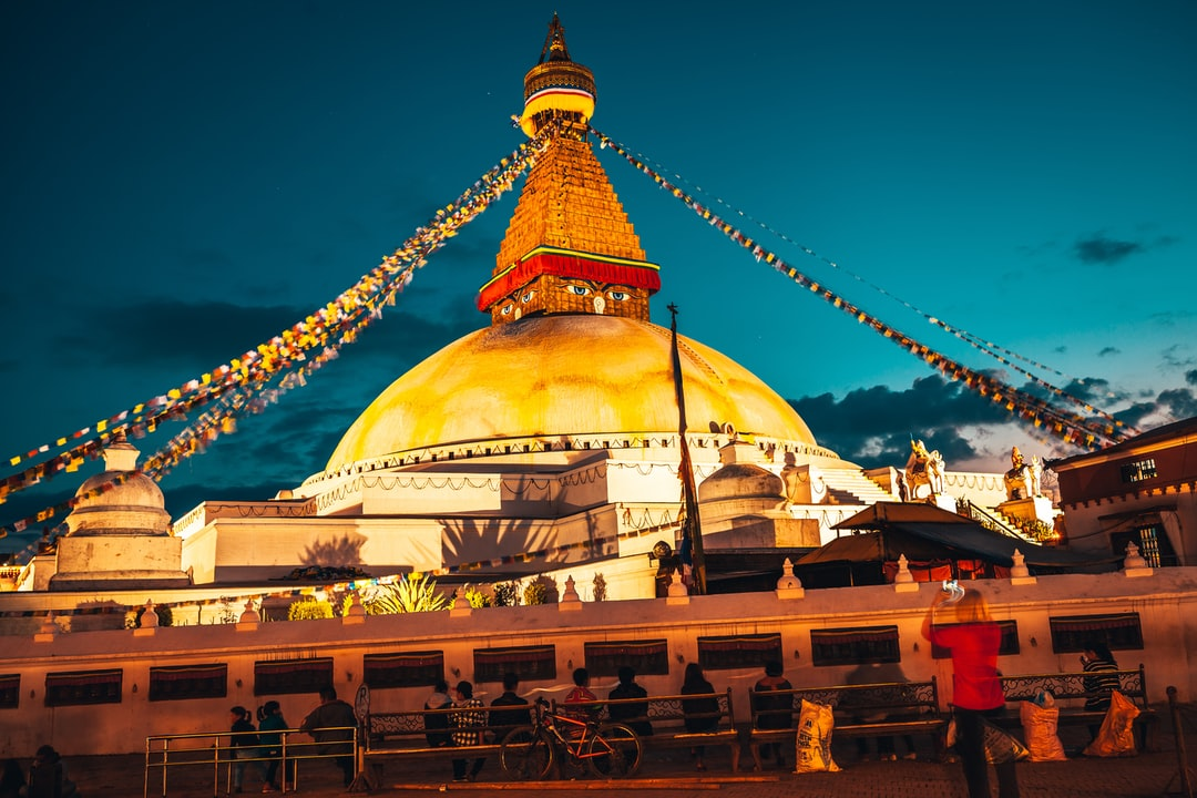 A large building with Boudhanath in the background