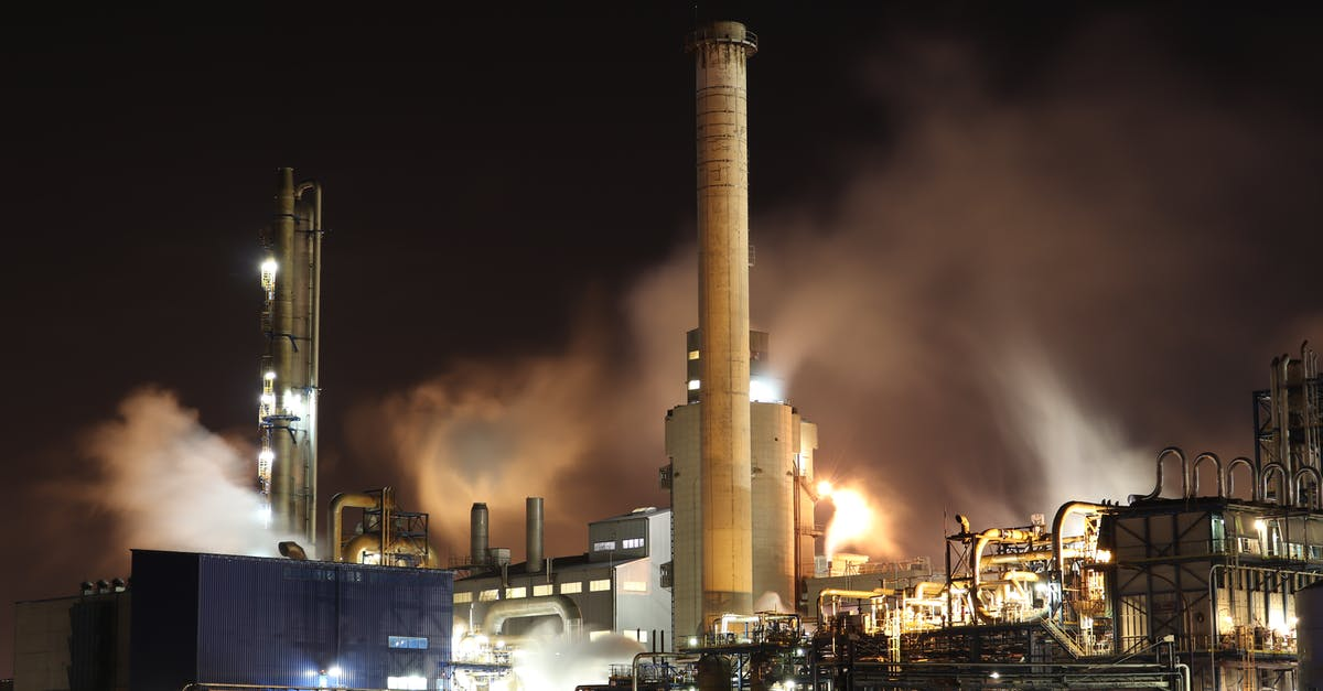 A factory with smoke coming out of it